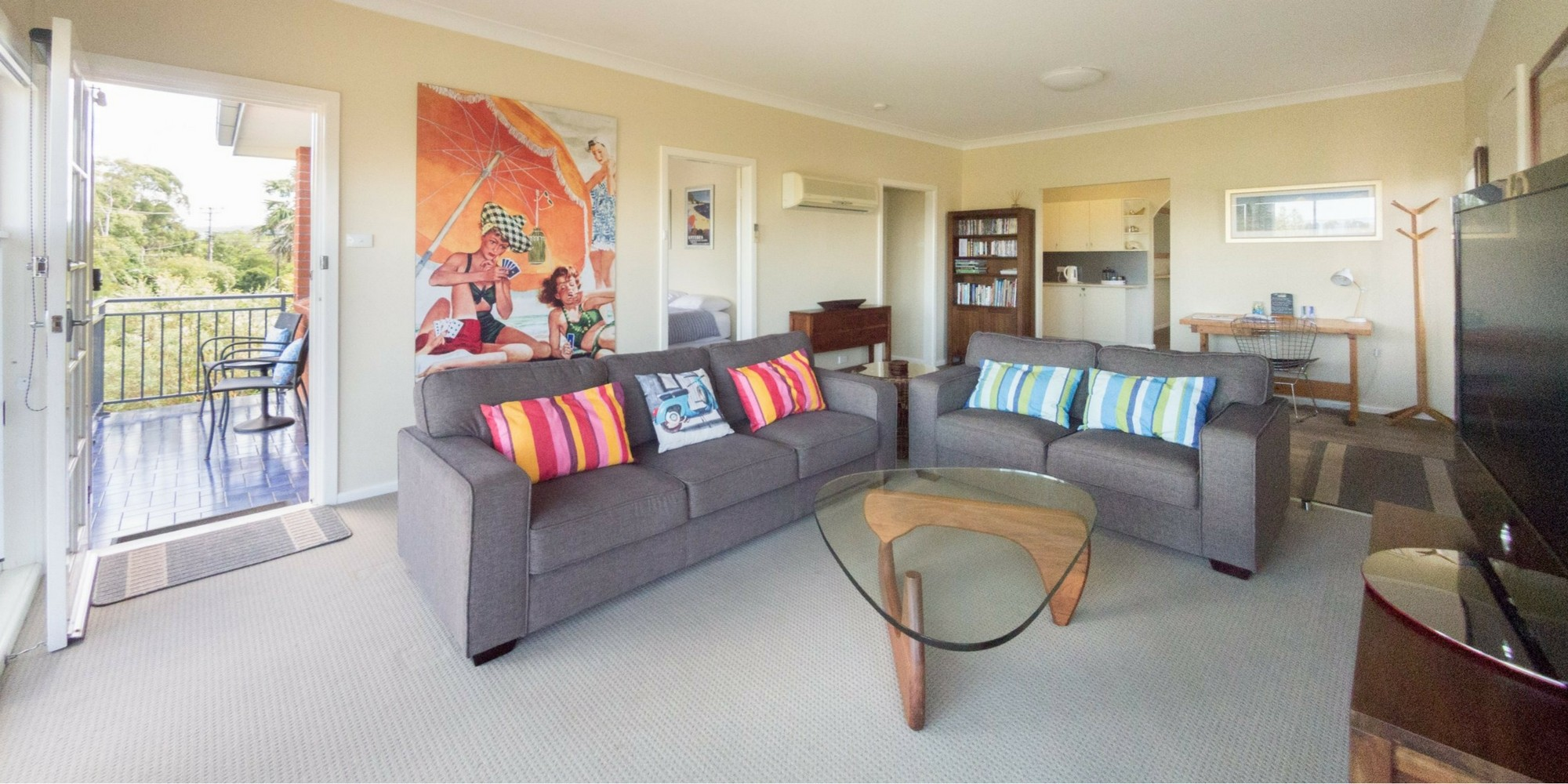Front living room with balcony at Southerly Change, holiday rental accommodation at Seven Mile Beach, Gerroa