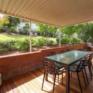 Rear deck & backyard at Southerly Change, holiday house rental accommodation at Gerroa, Seven Mile Beach