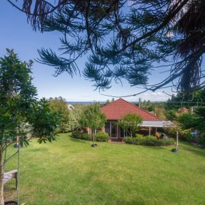 Back yard with ocean views at Southerly Change, holiday house rental accommodation at Gerroa, Seven Mile Beach