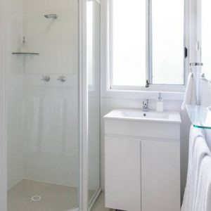 First bathroom with shower at Southerly Change, Gerroa holiday house accommodation at Seven Mile Beach, NSW