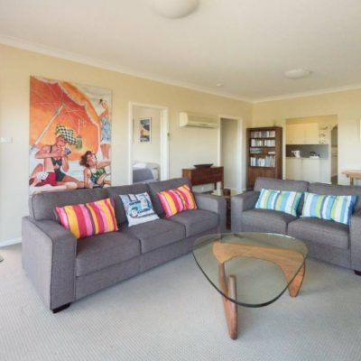 Front living room & balcony at Southerly Change, Gerroa holiday house accommodation at Seven Mile Beach, NSW