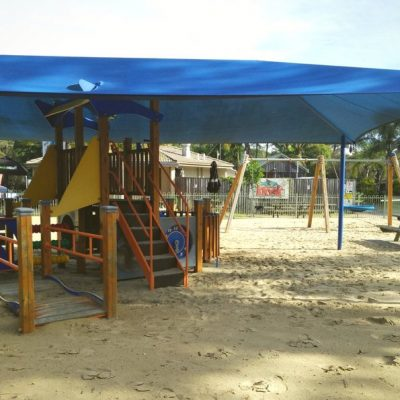 Fenced & covered playground next to kiosk at seven mile beach gerroa